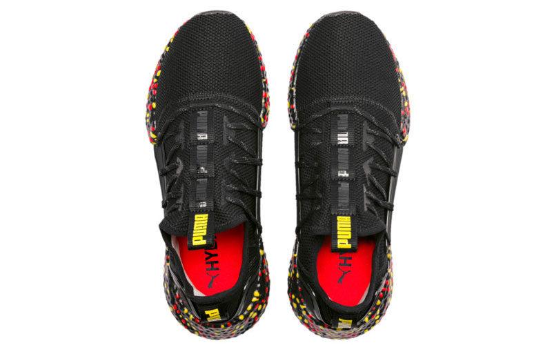 Puma hybrid rocket runner sneakers zwart/rood